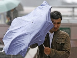 Pedestrian struggles with an umbrella in strong winds brought about by Typhoon Parma in Taipei